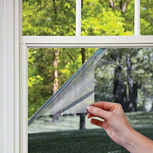 Two way mirror window film