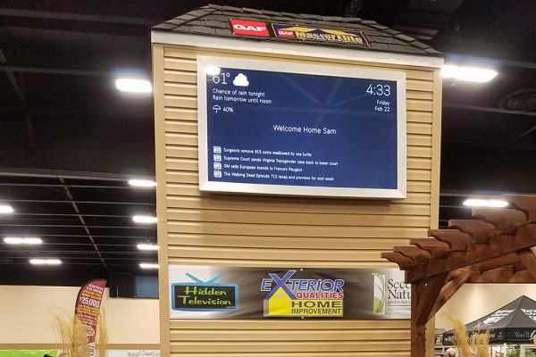 Framed to the viewable area of the screen, this smart mirror is on top of a huge display grid to show off it's features. It is letting people know about the weather, the time and more.