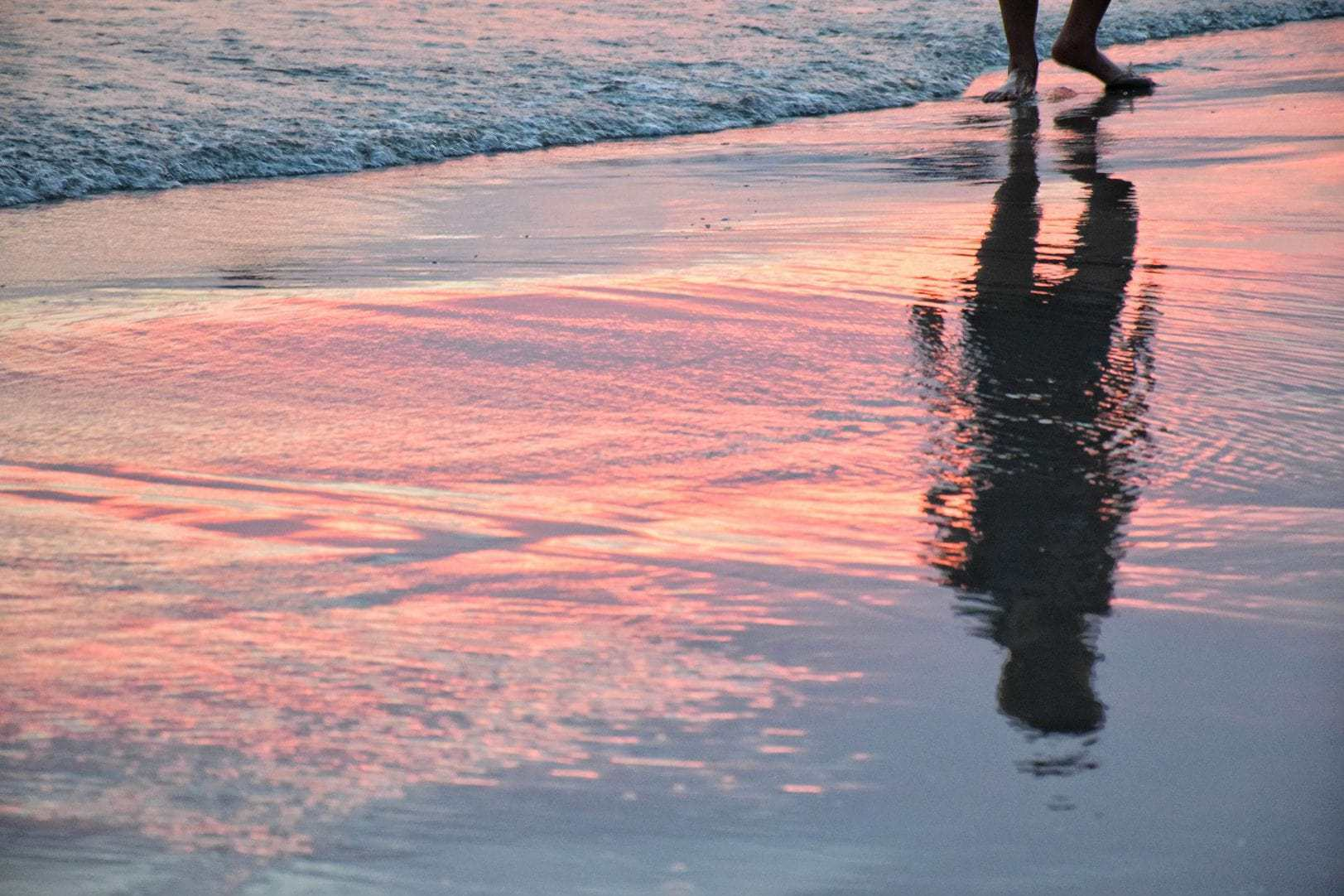 Reflection on water and sand.