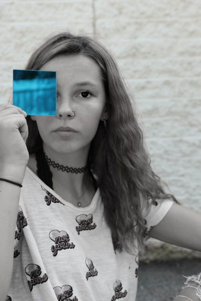 This is natasha in an edited picture holding colored glass.