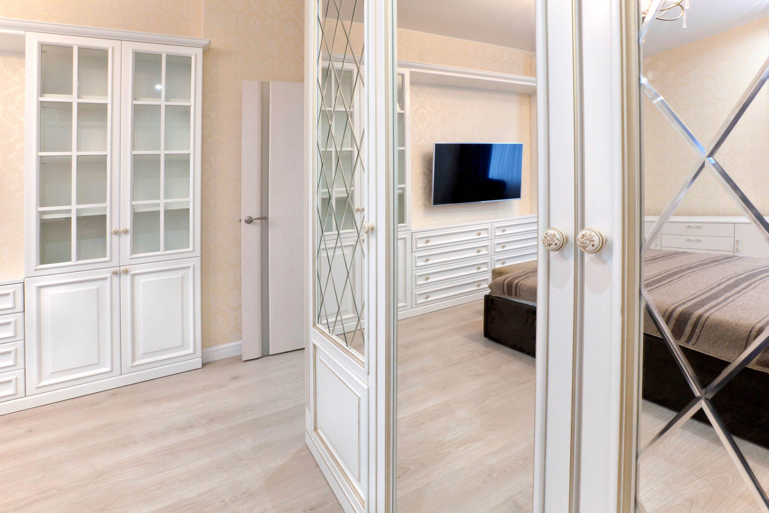 Beveled mirror on decorative door